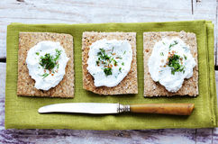 Rye loaves with homemade cottage cheese cream and chopped dill Royalty Free Stock Photography