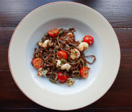 Rye pasta with capers and prawns. Shot from above Stock Images