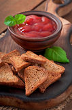 Rye rusks with spicy sauce Stock Photos
