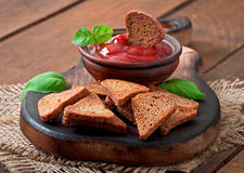 Rye rusks with spicy sauce Stock Photography