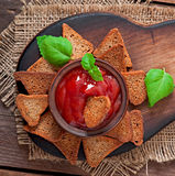 Rye rusks with spicy sauce Stock Photo