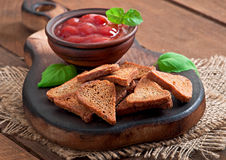 Rye rusks with spicy sauce Royalty Free Stock Photography
