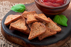 Rye rusks with spicy sauce Royalty Free Stock Photos