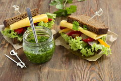 Rye sandwich with cheese, vegetables, pesto Stock Photo
