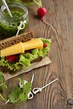 Rye sandwich with cheese, vegetables and pesto Royalty Free Stock Photo