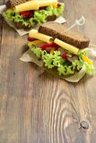 Rye sandwich with cheese, vegetables and pesto Royalty Free Stock Image