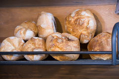 Rye scones in shelf of bakery. Newly-baked scones and buns in modern bakery Stock Image