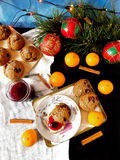 Rye scones surrounded by Christmas decorations. Rye scones with dried cranberries surrounded by Christmas decorations stock photos