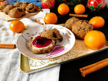 Rye scones surrounded by Christmas decorations. Rye scones with dried cranberries surrounded by Christmas decorations royalty free stock photography