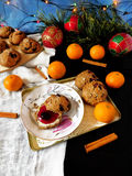 Rye scones surrounded by Christmas decorations. Rye scones with dried cranberries surrounded by Christmas decorations stock images