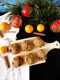 Rye scones surrounded by Christmas decorations. Rye scones with dried cranberries on a wooden board surrounded by Christmas decorations stock photos