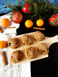 Rye scones surrounded by Christmas decorations. Rye scones with dried cranberries on a wooden board surrounded by Christmas decorations stock images