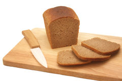 Rye sliced bread on the wooden desk Stock Photos