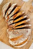 Rye sourdough homemade bread on wooden plate. Rye sliced sourdough bread on wooden plate. Baked at home, 100% natural Royalty Free Stock Images