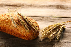 Rye spikelets and bread Royalty Free Stock Photo