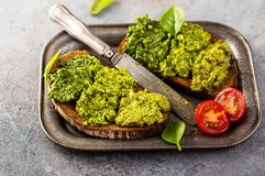 Rye toast with fresh pesto stock photography