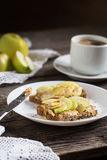 Rye toast with peanut butter, apples and honney and coffee Stock Photo
