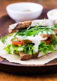 Rye toast sandwich with green leaf, tomato and chicken Royalty Free Stock Images