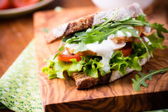 Rye toast sandwich with green leaf, tomato and chicken Royalty Free Stock Photography