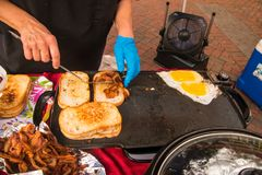 Toast bacon and eggs on a griddle stock image