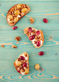 Rye and wheat toasts with baked grape on blue table Royalty Free Stock Photos