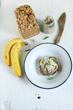 Rye wholegrain sandwich with nut butter, banana and terragon breakfast Stock Image