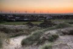Rye wind farm viewed from Camber Sands. Stock Photo