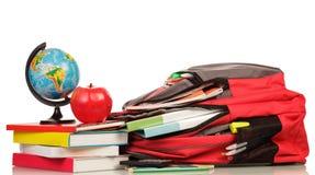 Ryggsäck med skolatillförsel Royaltyfria Bilder