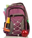 Ryggsäck med skolatillförsel Arkivfoton