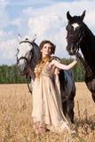 rym kvinnan för hästar två Fotografering för Bildbyråer