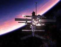 Rymdstation som kretsar kring den blåa planeten Arkivfoto