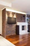 Rymlig lägenhet - tegelstenvägg Arkivbilder