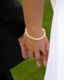 rymma för 2 händer Royaltyfri Fotografi