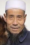 Rynkig framsida av en muslimsk försäljare i Peking, Kina Arkivfoton