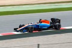 Ryo Haryanto conduce el señorío que compite con el coche del MRT en la pista para el Fórmula 1 español Grand Prix en Circuit de C Foto de archivo libre de regalías