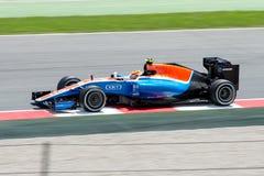Ryo Haryanto conduce el señorío que compite con el coche del MRT en la pista para el Fórmula 1 español Grand Prix en Circuit de C Fotografía de archivo libre de regalías