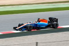 Ryo Haryanto drives the Manor Racing MRT car on track for the Spanish Formula One Grand Prix at Circuit de Catalunya Royalty Free Stock Photo