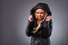 RYoung woman in a jacket Stock Image