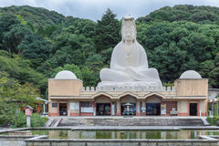 Ryozen Kannon WW II Memorial shrine. Kyoto, Japan - September 19, 2016: The Ryozen Kannon WW II Memorial shrine is set against forested hills. The giant statue Stock Photography