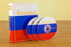 Rysk bok med flaggan av Ryssland och CD disketter på trätablen stock illustrationer