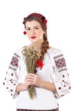 Rysk flicka i nationell dräkt med en bukett Royaltyfri Bild