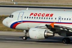 Rysk flygbolagflygbuss A319-111 för EI-EYM Rossiya Arkivbild