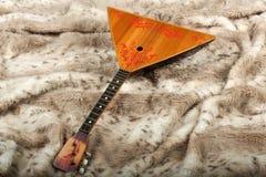 Rysk musikalisk nationell instrumentbalalajka arkivbilder