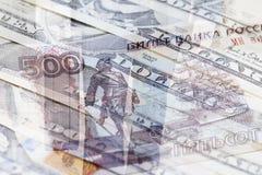 Rysk rubel och US dollar Arkivfoto