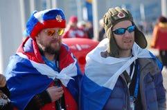 Ryska åskådare med flaggor på XXII vinterOS Sochi Royaltyfri Bild