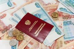 Ryska pengar och ett pensioncertifikat Fotografering för Bildbyråer