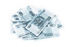 Ryska rubel g?r sammandrag f?rg p? vit bakgrund