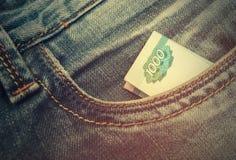 Ryska rubel i jeans Fotografering för Bildbyråer