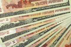 Ryska rubel och dollar bakgrund Arkivbilder