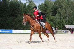 RYSKI, LATVIA, SIERPIEŃ - 12: Latvian sportowa Guntars Silinsh ridi Zdjęcie Royalty Free